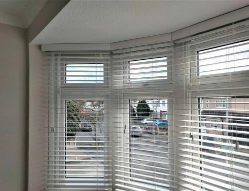 White wooden venetians in a bay and showing pelmets