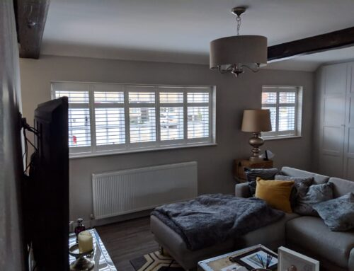 White plantation shutters with midrails